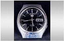 Seiko Gents Automatic Wristwatch, black dial, silvered battons and hands, with day date aperture, faceted crystal glass, screw down back numbered 830782. Ticking but not tested for accuracy.