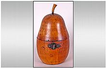 A George III Pearwood, Pear Shaped Tea Caddy c 1790. With original lock and escutcheon. Includes key. In good condition.