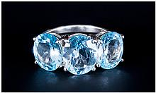 Sky Blue Topaz Three Stone Ring, the central oval cut topaz being 4.5cts, with the similar stones to either side measuring 3.25cts each, giving a generous total of 11cts, which creates an excellent finger-wide display of the sparkling sky blue stone,