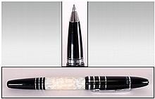 Mont Blanc Ltd Edition F. Scott. Fitzgerald Ball Point Pen, This Elegant Instrument Is Crafted From White Marbled Resin, Edged In Gleaming Black and Striped with Bands of Sterling Silver. Complete with Box and Outer Sleeve. Condition Report - A