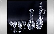 Two Cut Glass Decanters together with 6 sherry glasses.