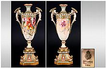Royal Worcester Hand Painted Renaissance Style Vase, polychrome floral decoration on a gloss blush ivory ground, to the body, with cockatrice handles to either side, supported on an ivory socle above a Renaissance style square base with canted