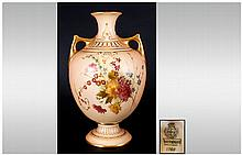 Royal Worcester Hand Painted Blush Ivory Two Handled Vase. c.1900. With Floral Decoration and Gold Handles and Borders. Excellent Condition. Stands 7.5 Inches High.