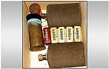 Mixed Lot, Comprising Two Early 20thC Water Bottles, Shell Case And Five Unused ''Lodge'' Spark Plugs In Original Metal Containers