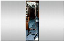 Modern Cheval Rectangular Mirror with beech effect finish to rear. Chrome frame and castor feet. 62 inches high and 16 inches wide.