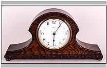 Thomas Russel Liverpool -  Napoleon Shaped Oak Cased Mantel Clock. 8 Day Movement, White Porcelain Dial. Good Condition and Working Order. 5.5 Inches High, 10.5 Inches Wide.