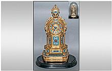 Decorative French 19th Century Boudoir Gilt Metal and Sevres Style, 8 Day Striking Mantel Clock. Complete with Stand and Glass Dome. Clock Stnads 18.5 Inches High, Height with Glass Dome 22.5 Inches. Excellent Condition and Working Order,