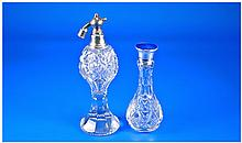 Silver Topped Perfume Bottles, 2 in total.