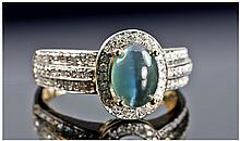 A Fine Alexandrite - Cats Eye and Diamond Ring.