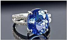 A Single Stone Oval Tanzanite Ring, set in 14ct