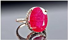 18ct Rose Gold Set Single Stone Ruby Ring. Flanked