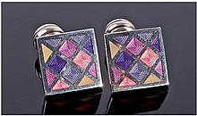 An Attractive Pair of Silver and Enamel Cufflinks,