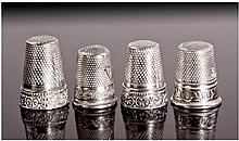 Four Silver Thimbles. All with shield shaped