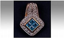 9ct Gold Diamond And Blue Topaz Pendant Drop.