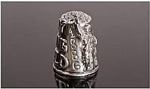 An American Silver Thimble featuring an image of
