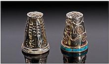 A Pair of Silver Thimbles, one with a rim set with