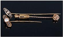 Three Various Stick Pins, one marked 15ct, with a
