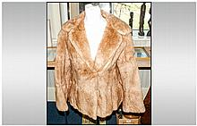 Ladies Light Brown Musquash Jacket fully lined. Slit pockets. Hook & loop f