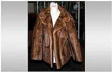 Ladies Light Brown Mink Jacket, Fully lined, collar with revers. Label read