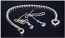 A Silver And CZ Set Bracelet. With silver and