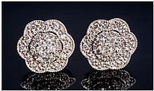 A 9ct Set Pair Of Diamond Cluster Earrings. Flower