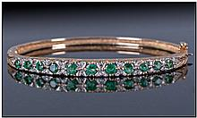 Ladies 9ct Gold Emerald And Diamond Hinged Bangle.