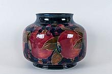 William Moorcroft Tube lined Bulbous Shaped Vase, Decorated with Pomegranat
