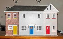 Large Dolls House made of wood and decorated throughout with a fitted bathr