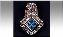 9ct Gold Diamond And Blue Topaz Pendant Drop.