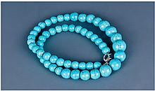 A Turquoise Matrix Necklace with White Metal