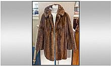 Short length Mink Coat. Slit pockets, fully lined.