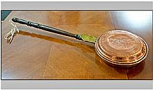 Copper and Brass Warming Pan with wooden handle,