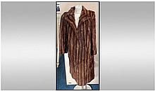 Knee Length Mink Coat. Slit pockets, fully lined.