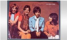 The Small Faces. 3 autographs on 1960's picture.
