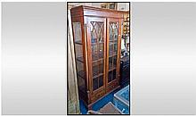 Reproduction Walnut Glazed Front Standing Bookcase