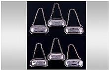 A Silver Set of Six Matching Spirit Labels, All