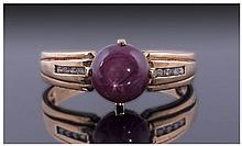 Star Ruby and Diamond Ring, round cut cabochon