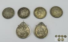 A Good Collection Of Six Silver Crowns. Includes; 1) American Silver Eagle/