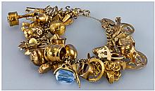 9ct Gold Bracelet Loaded With 43 9ct Gold Charms.