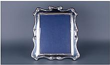 A Fine And Large Modern Silver Shaped Photo Frame.