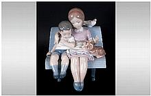 Lladro Figure 'Surrounded By Love' model number 6446, issued 1997. 7'' in h