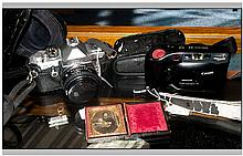 2 Cameras, MX Pentax ASAHI In Black Leather Case And A Canon Sure Shot EX T