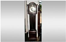 Brass Faced Grandmother Clock in a Mahogany case with a glazed door, exposi