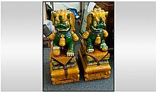 A Pair Of Chinese Foo Temple Dogs On Stand, glazed