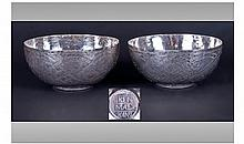 A Pair Of Nigerian Silver Bowls. Decorated with