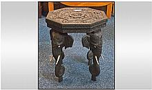 Small Burmese teak wood octagonal shaped elephant