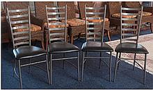 Set of Four Metal Framed Dining Chairs with black