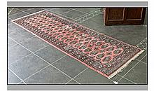 Persian Style Rug, predominantly salmon coloured