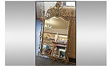 Brass Framed Mirror. Size 37 x 22 inches.