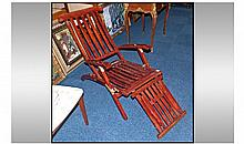 A Reproduction Teak Steamer Chair, with brass